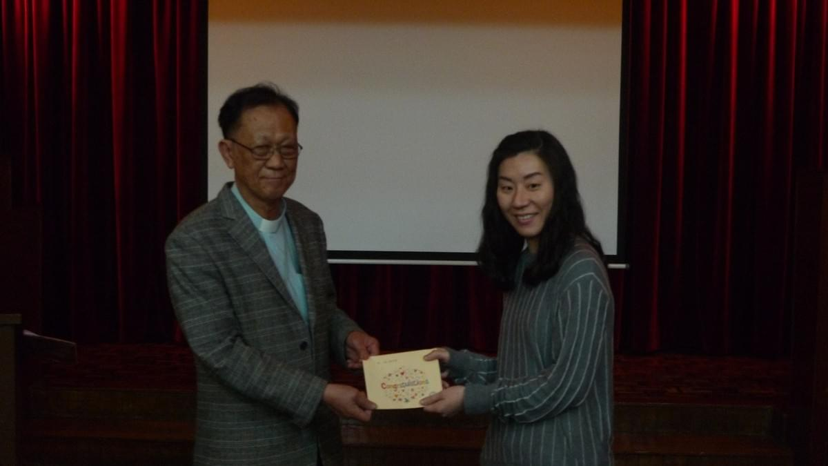 Dr. IP Awarding the Scholarship to Ms. CHEN Siu Lan