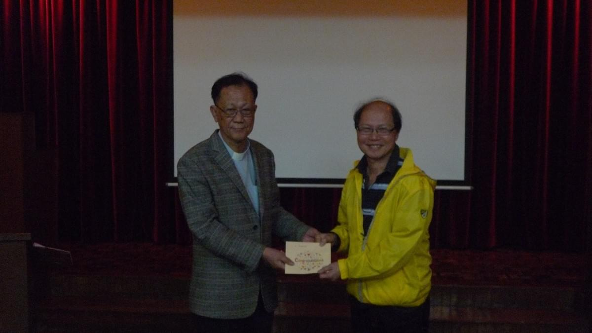 Dr. IP Awarding the Scholarship to Mr. LEE Bing Shum