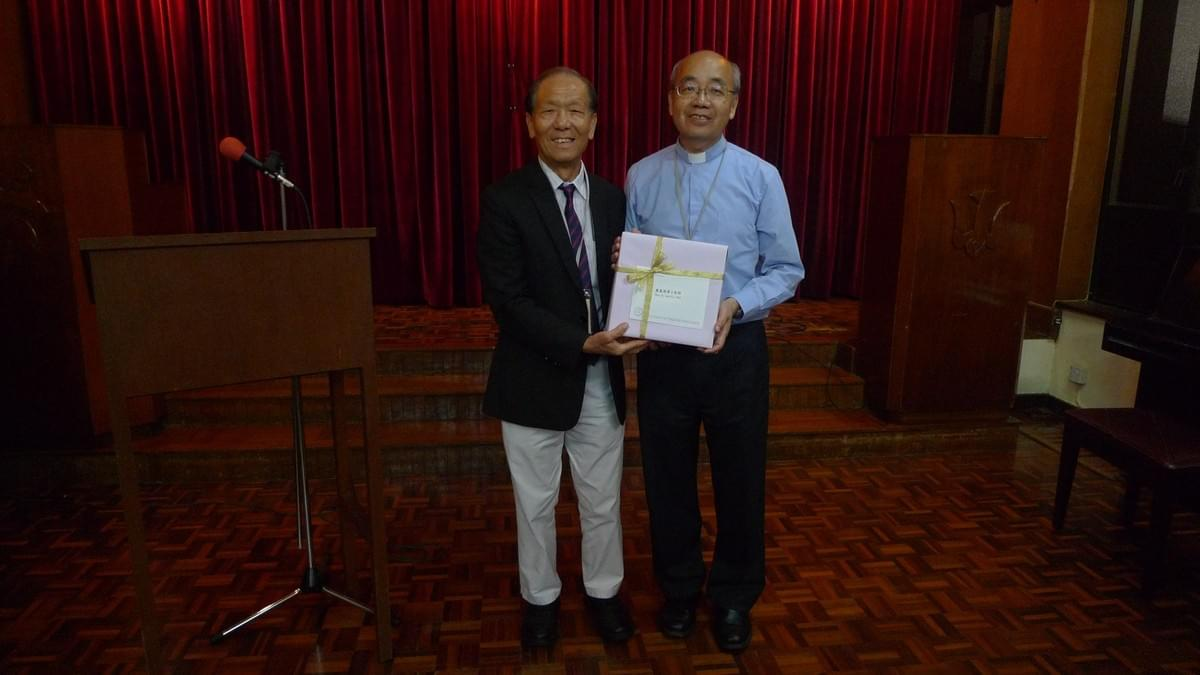 Rev. Paul CHAN Presenting a Gift to the Lecturer