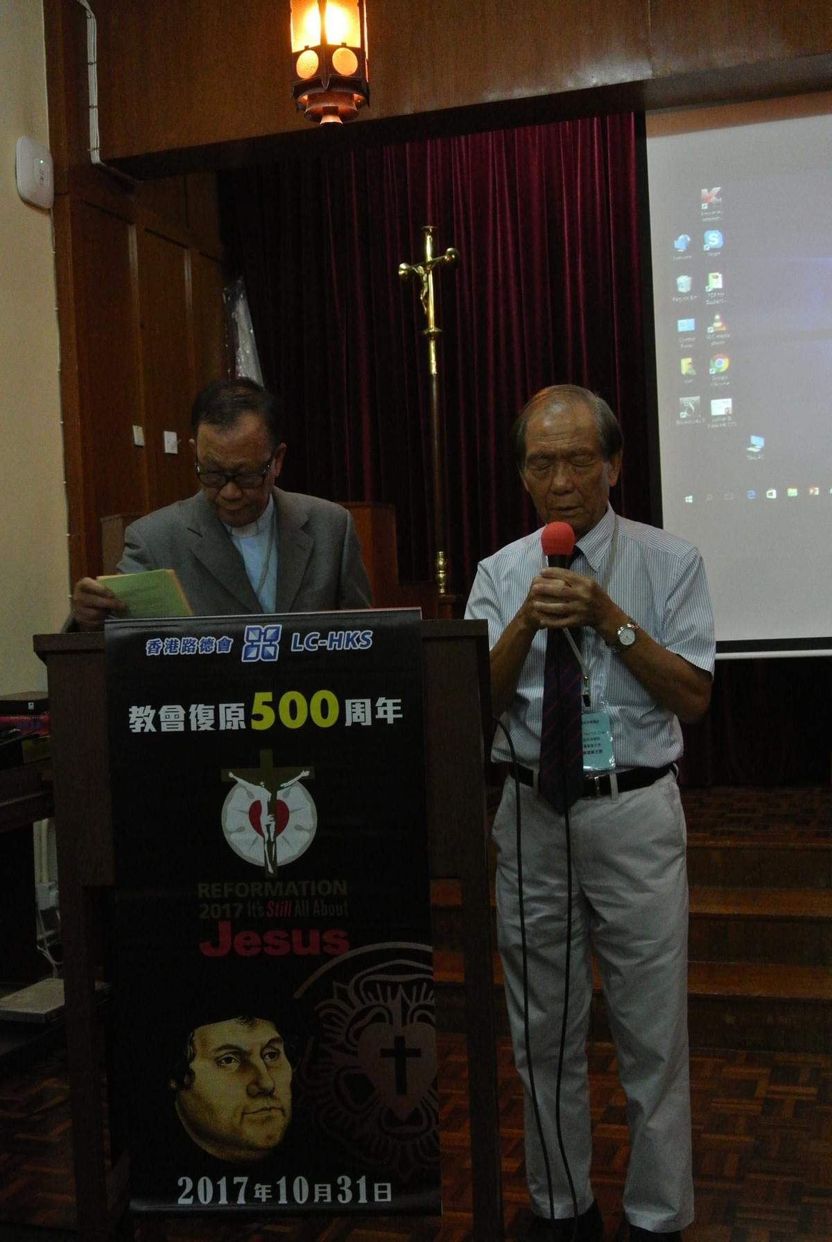 Rev. Paul Y. S. CHAN, Chairman of the Seminary Board of Control, Saying a Benediction