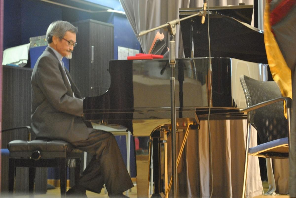 Rev. Kam Kei FUNG Playing the Piano