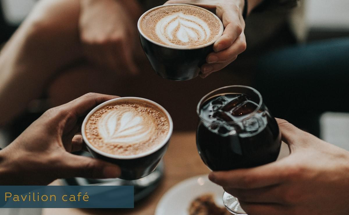 This picture shows three hands holding coffee cups.