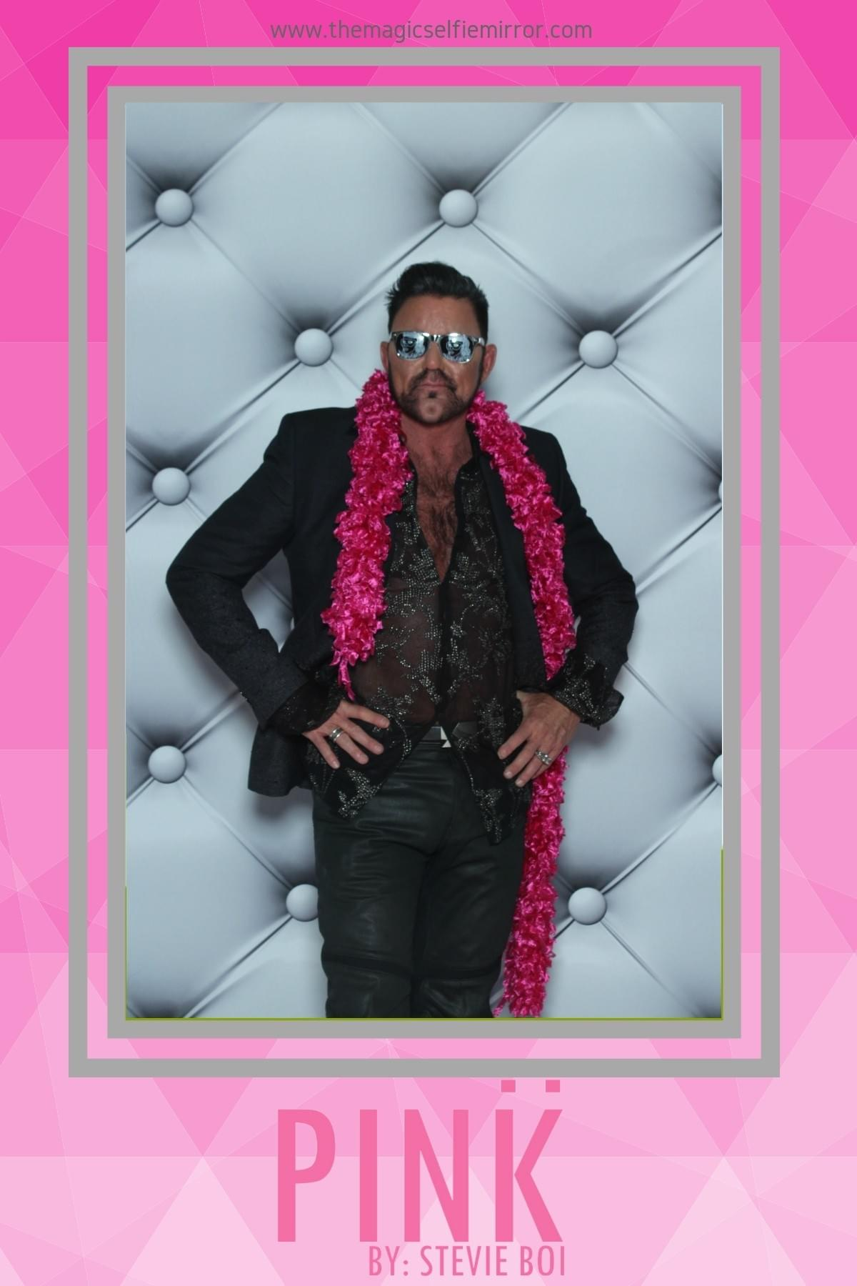 Founder of Phoenix Risen Studios - Logan Curtis with The Magic Selfie Mirror photo booth at New York Fashion Week