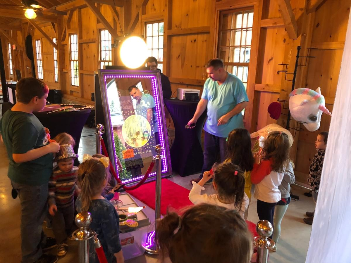 Kids enjoying the Magic Selfie Mirror Photo Booth