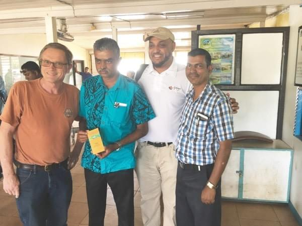 Asst Agriculture Minister of Fiji Mr. Viam Pillay holding a craft chocolate bar by Ned & Debi of Cello Chocolate