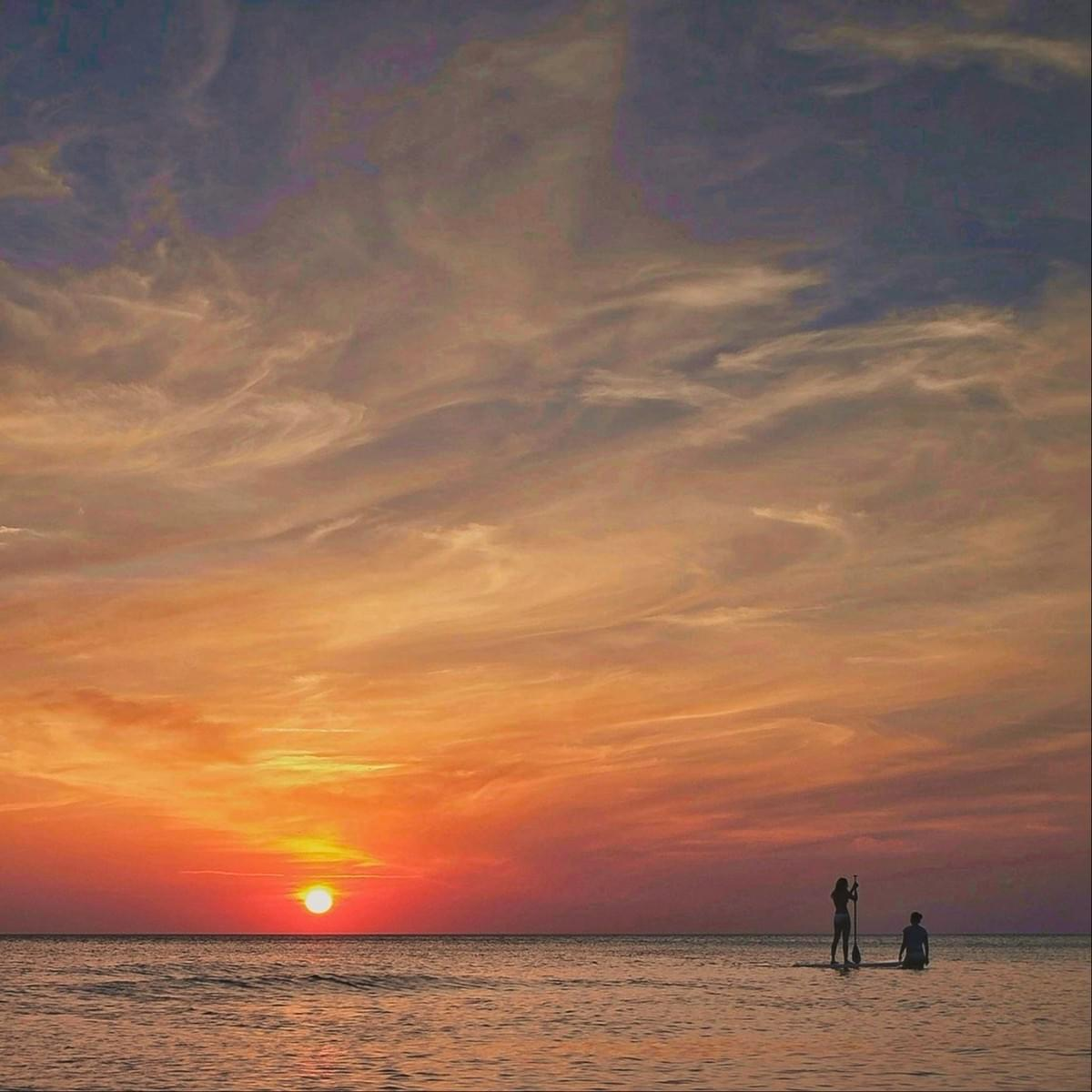 Enjoy a unobstructed sunset on a paddle board!