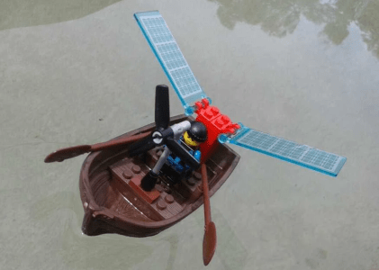 Lego sculpture of a row boat with solar panels