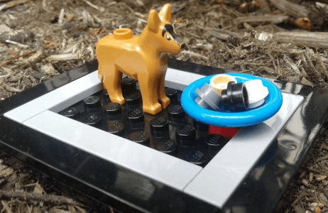Lego sculpture of a dog showing that pet food can be high-carbon