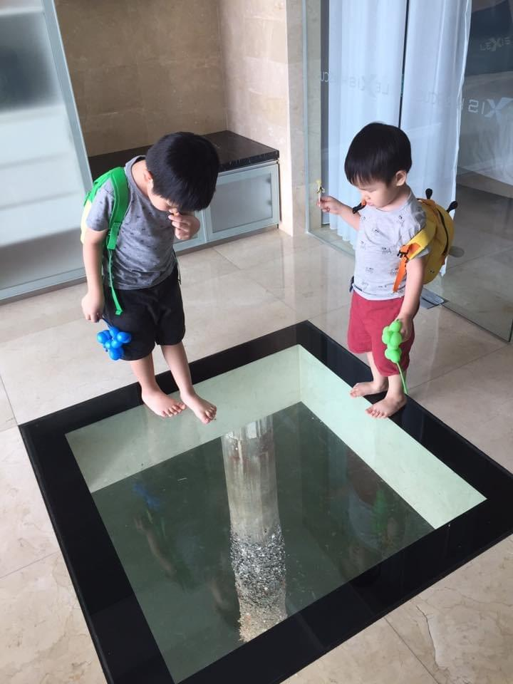 boys looking at the sea through the glass lexishibiscus #portdickson #beachholiday #beachgetaway #familytravel #travelwithkids #malaysia