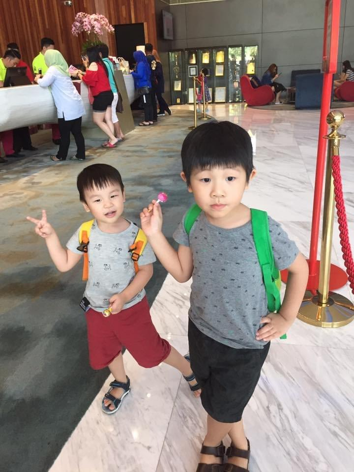 boys posing with their lollipops at lexis hibiscus #lexishibiscus #portdickson #beachholiday #beachgetaway #familytravel #travelwithkids #malaysia