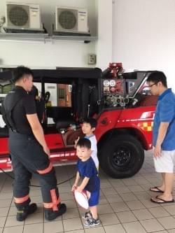 checking out the red rhino at scdf fire station open house