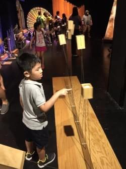 pendulum-like musical instrument at sound maze at the esplanade