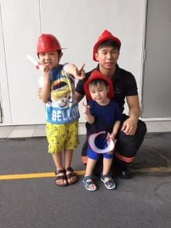 boys with mr fireman at scdf fire station open house