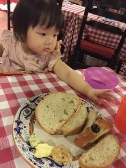 little girl enjoying bread at Pete's Place at Grand Hyatt Hotel