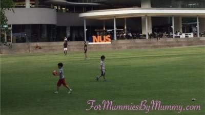 boys playing on open field at nus university town