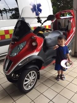 boy and fire bike at scdf fire station open house