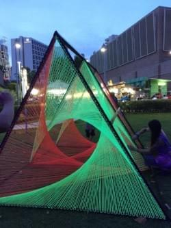 neon woven  structures for flip side exhibit at the esplanade