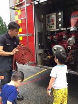 looking at different fire hoses at scdf fire station open house