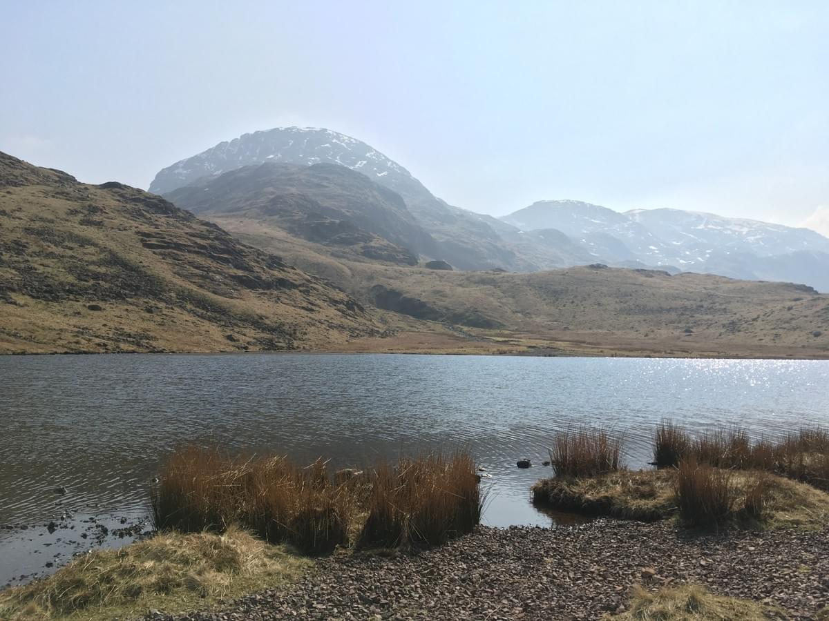 Angle Tarn looking towards Scafell Pike and Great End in the Lake District
