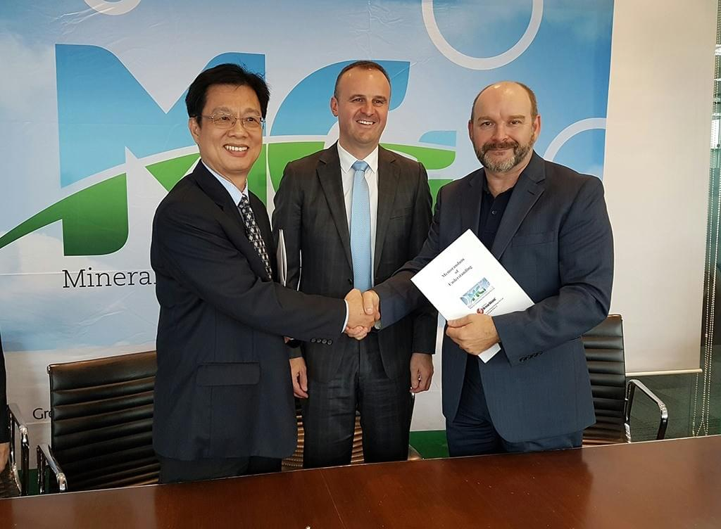 Signing of a partnership in Singapore with ACT Chief Minister Andrew Barr officiating.