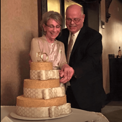 My father-in-law & mother-in-law cutting the cake at their 50th wedding anniversary party!