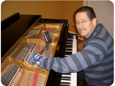 Rich Liptzin tuning a piano with electronic tuner