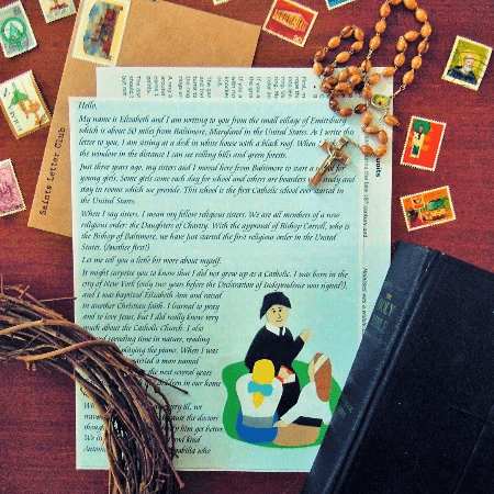 Saints Letter Club letter surrounded by a Bible, postage stamps, and a vine wreath
