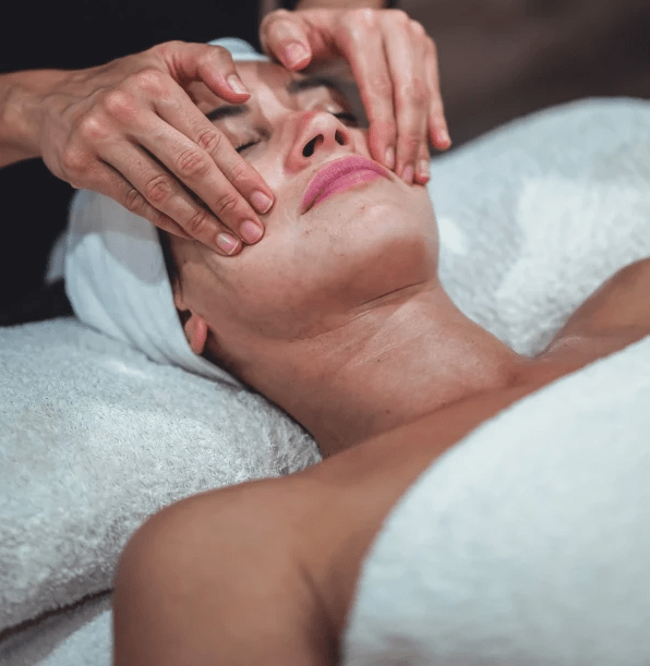 woman receiving a Face Massage at Atma Wellbeing by Saura Rates