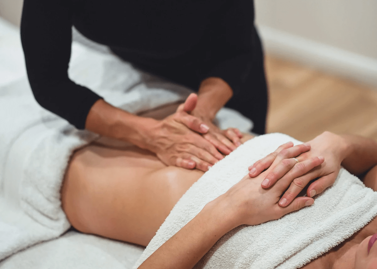 Woman receiving a Power Touch Lymphatic Massage at Atma Wellbeing by Saura Rates