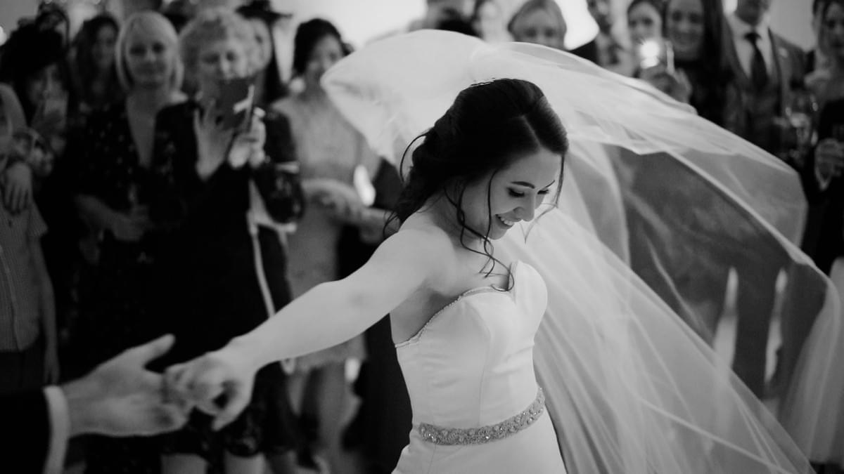 Eaves Hall Wedding, Lancashire wedding videographer, Bride, veil, first dance