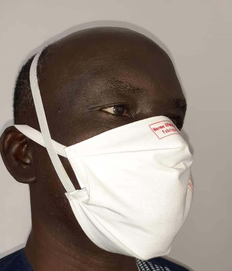 Sanoussi Diakite wearing the barrier face mask produced by the women he trained in Kolda, Senegal