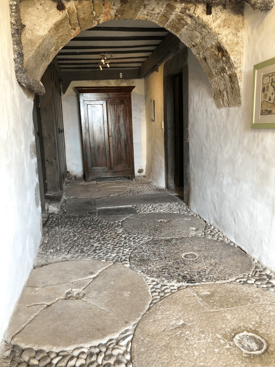 paved basement with old grinding stones