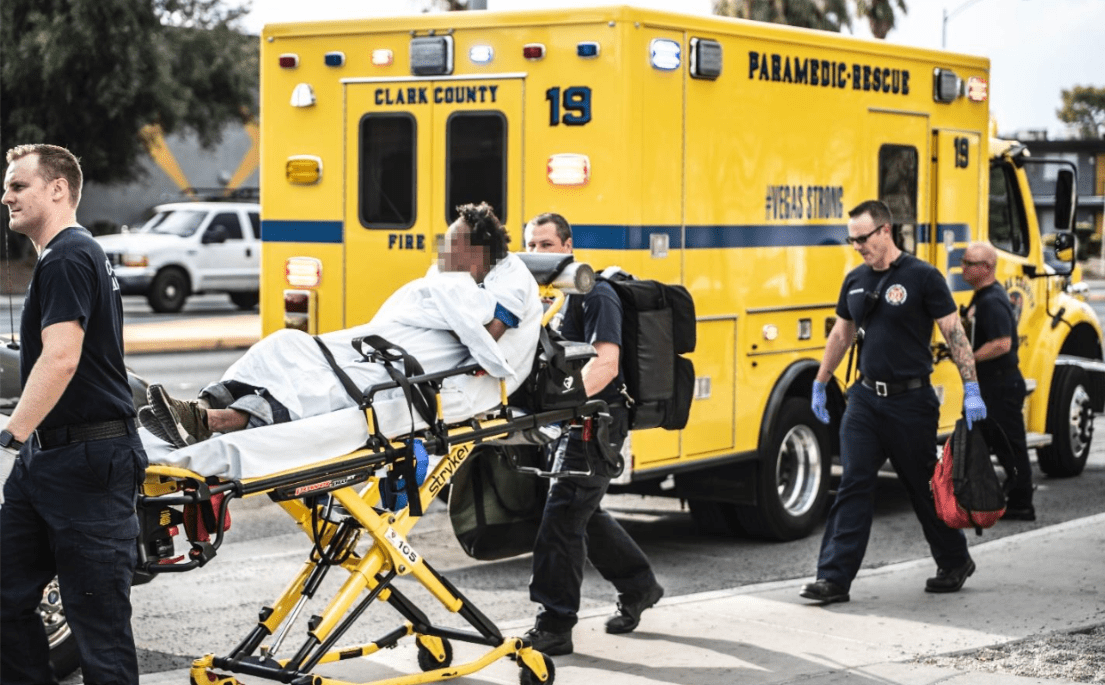 Paramedics bring to the ambulance truck to take to a hospital. Nevada. August 2, 2018. Photo by Eduardo D. Rossal