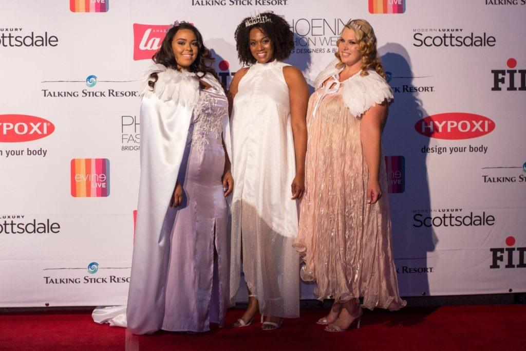 Plus size models on the red carpet wearing custom Nerecina Couture for a fashion week event