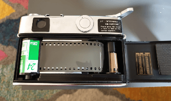 Yashica Ic Lynx 5000E camera from behind, showing a roll of Fuji Industrial film loaded, ready to close the back of the camera