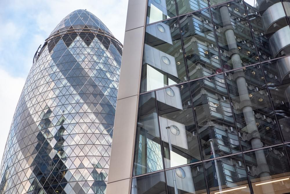 Willis Towers with the reflection of  Lloyd's of  London, The Gherkin behind
