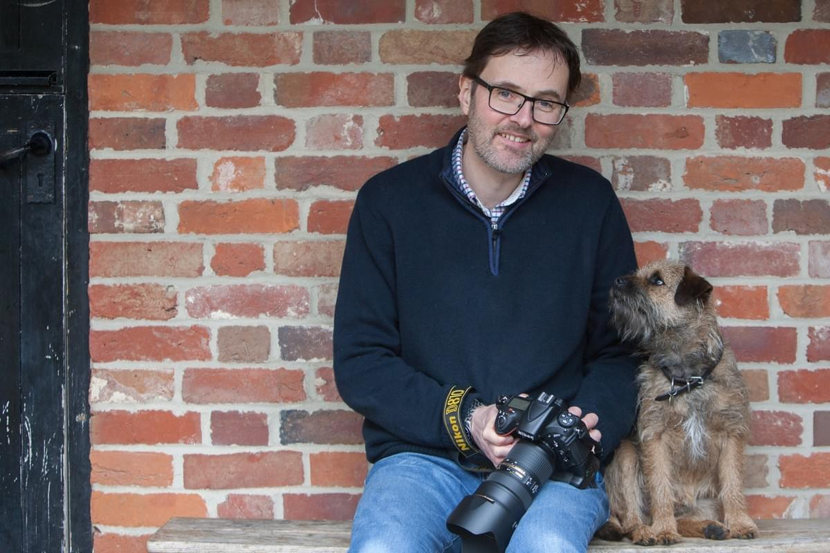 Border terrier nikon camera  who I am smile what are you doing