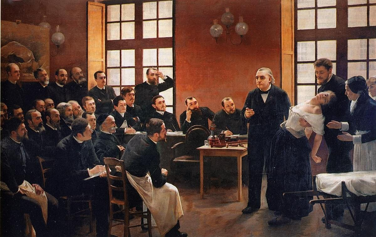 Painting of a hysteria patient, being put on display to a room of male doctors by Charcot.