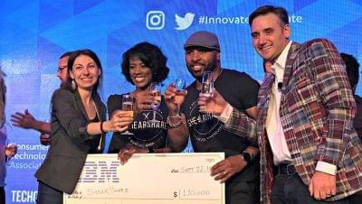 Jen Consalvo, Courtney Caldwell, Tye Caldwell, and Frank Gruber toast onstage as ShearShare wins Startup of the Year