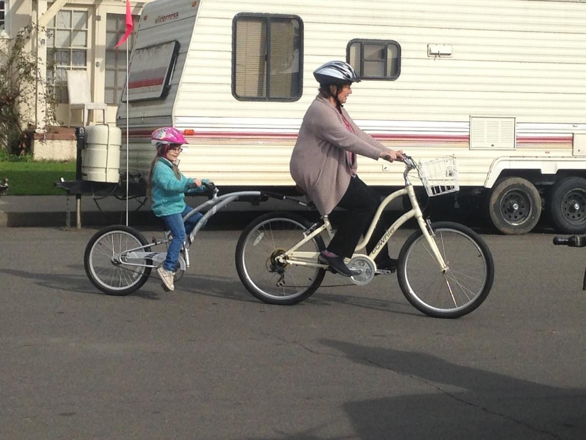 This grandma is having a great time riding a Trailabike with her granddaughter. Woohoo!