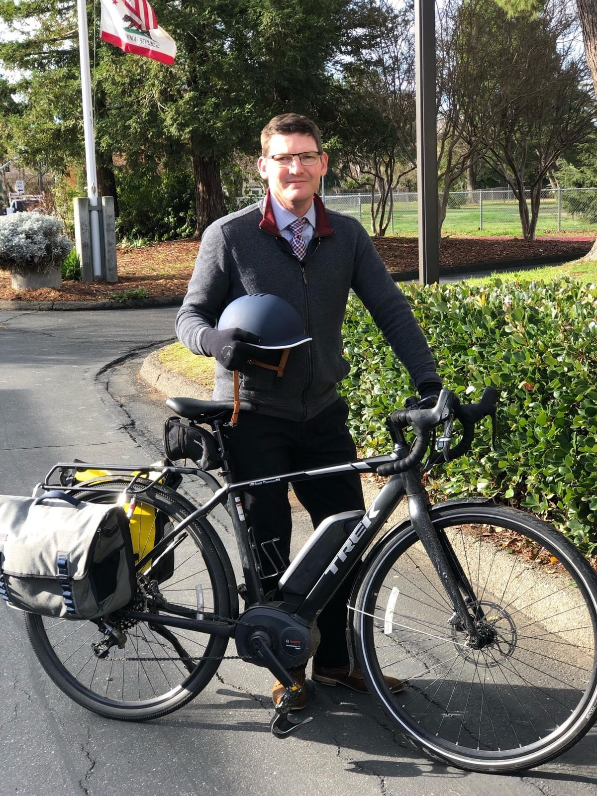 Scott Thomsen, Principal of Ralph Waldo Emerson Junior High School in Davis, commutes to work from Woodland most days, rain or shine, on his e-bike, which can reach 27 m.p.h.