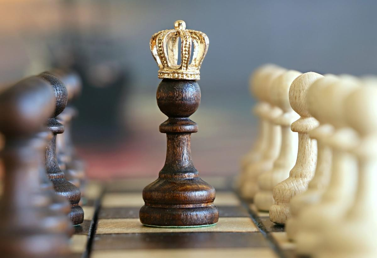 A lone, wooden chess piece with a crown on its head.  Take control of your credit.