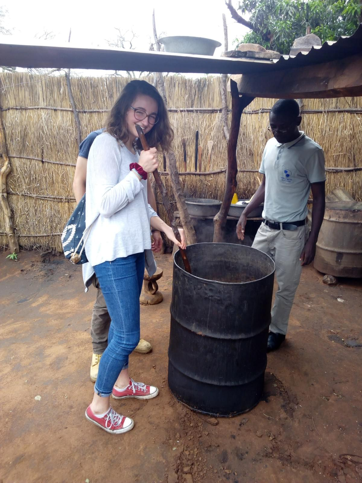 Mukuni Village, giving a hand in brewing the local beverage.