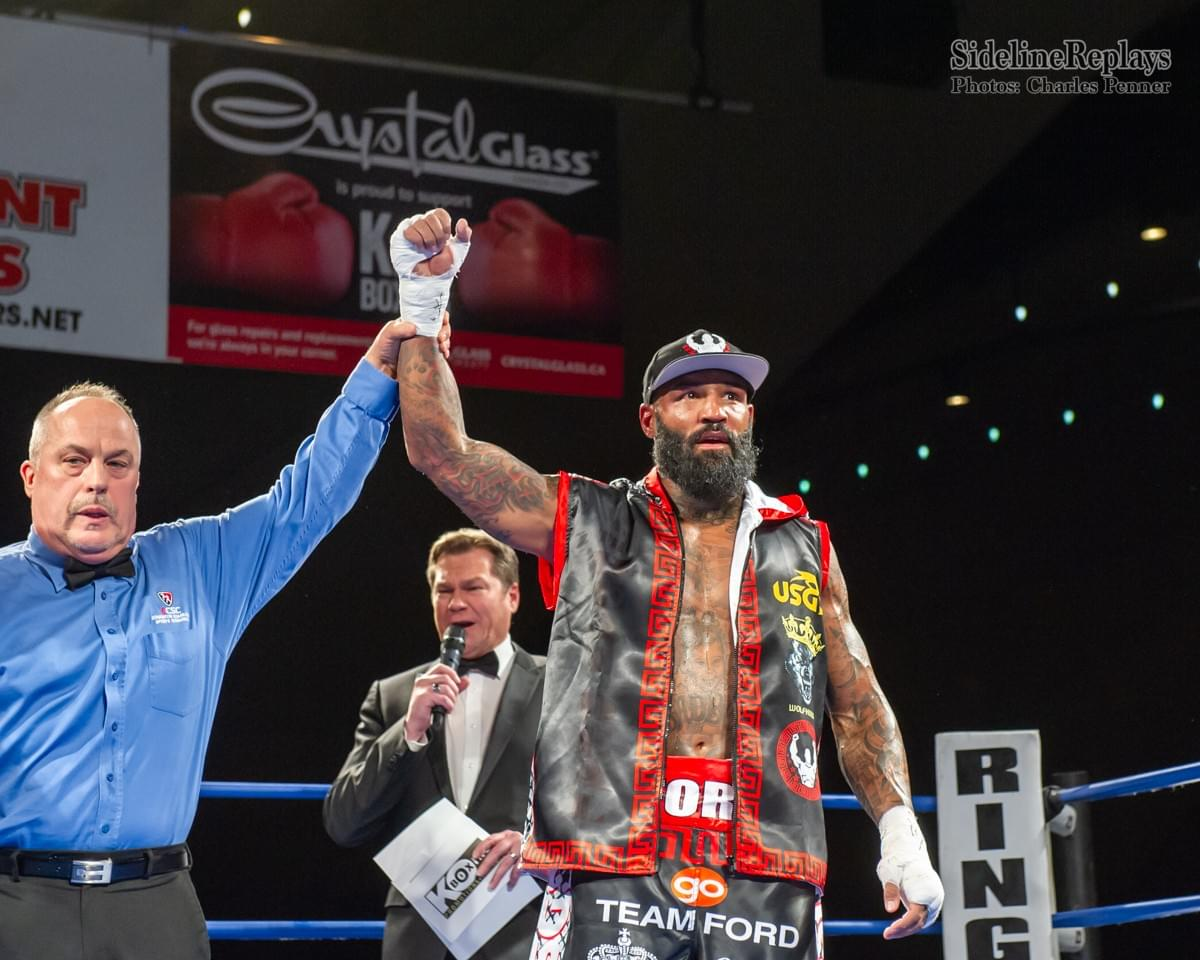 "(Above) Ryan ""the Real Deal"" Ford defeating Orlando Vazquez in the 6th and final round by TKO - Photo Charles Penner"
