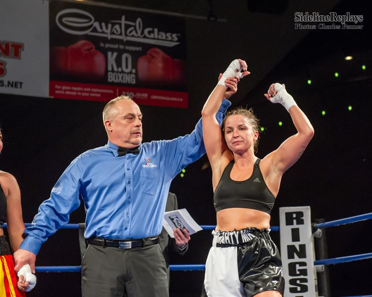 (Above) Mikenna Tansley moves to 3-0 defeating Ava Ruth Castro - Photo Charles Penner