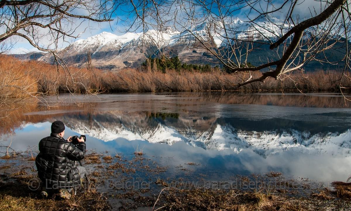 Winter snow refelcts in the calm water of the Glenorchy Lagoon