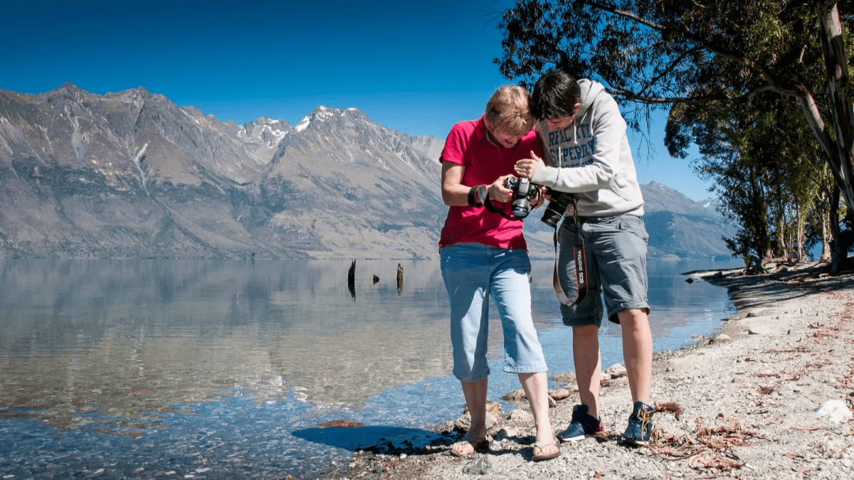 Photo tour clients compare their images at Little Paradise on Queenstown's Lake Wakatipu