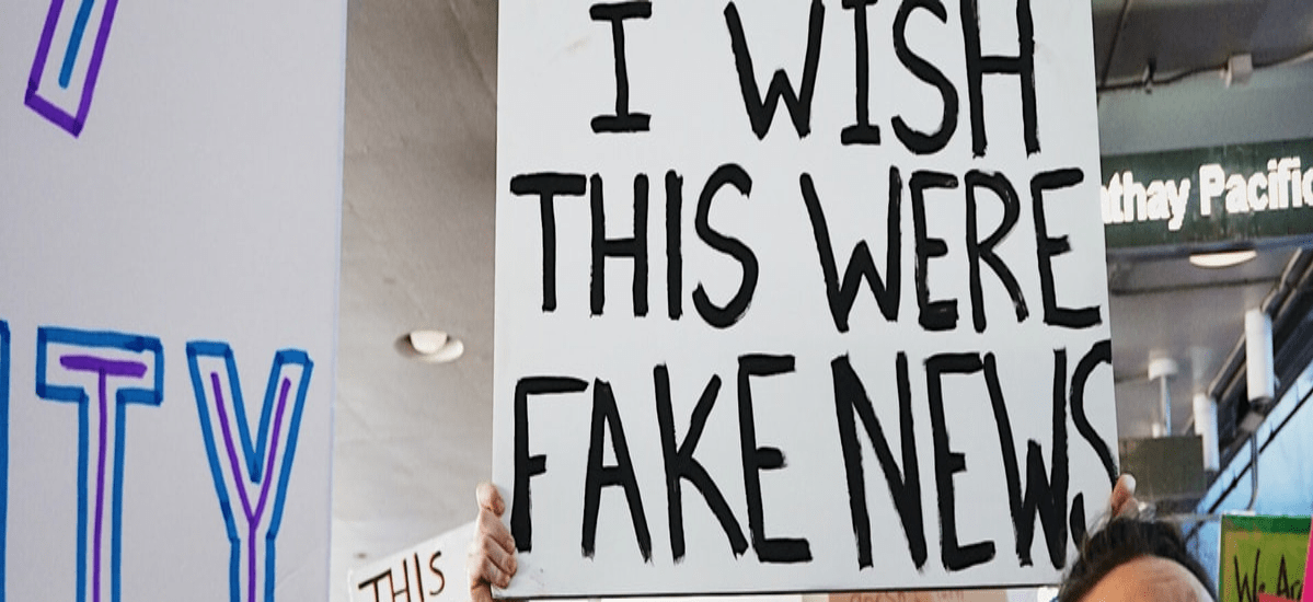 people protesting for the spread of fake news