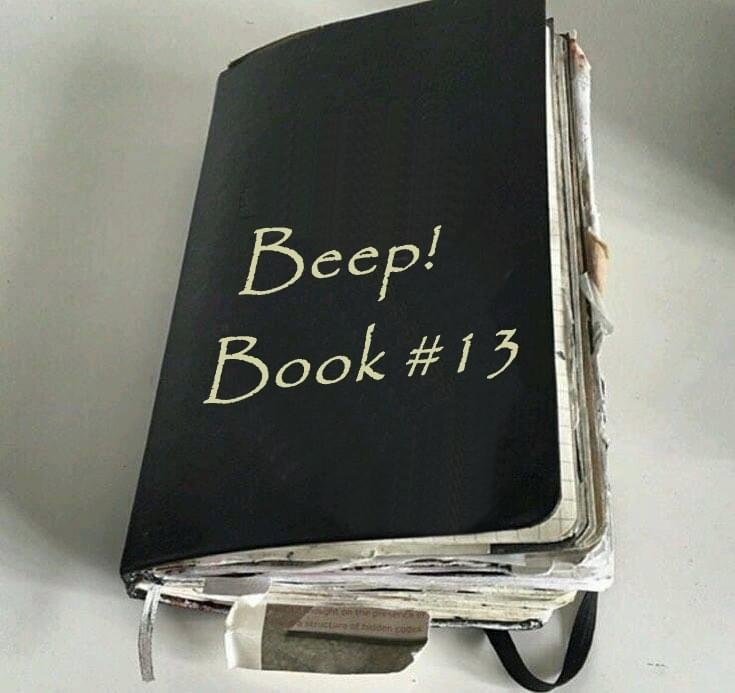 A used, dark green, pocket-sized Beep! Book full of paper scraps sticking out, titled 'Beep! Book #13'