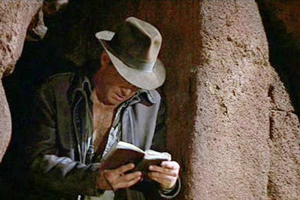 Indiana Jones checking his Beep! Book on one of his adventures